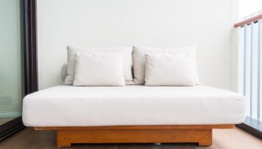 double-bed-with-white-pillows_1203-1321